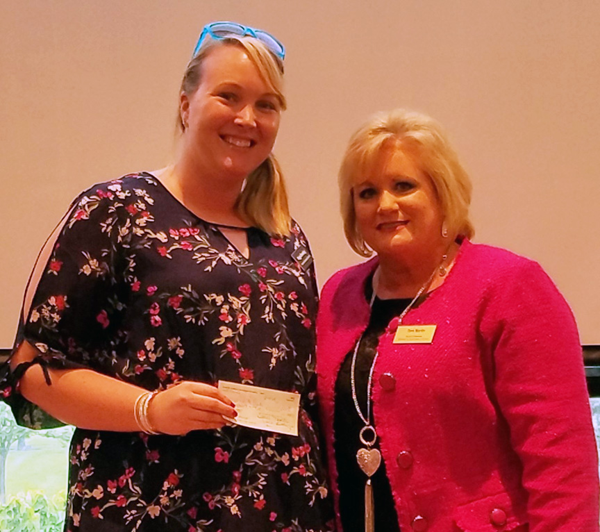 Maggie Breeding of the Boys & Girls Club accepting the check from WBC president Terri Martin
