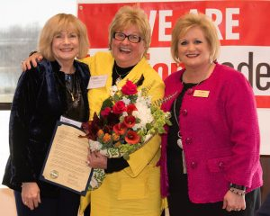 2018 ATHENA recipient Shary Williamson (center) receiving the ATHENA statue from program chair Diane Glassmeyer and WBC president Terri Martin.